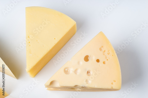 Different types of cheese on white background