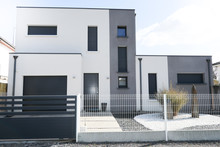 White Gray House Exterior With Entrance Door And Garage
