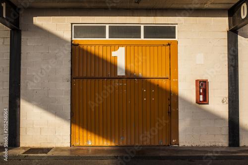 Garage door with number one