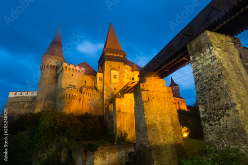 Poster Europa Photo of Corvin Castle which is histirical landmark on sunset