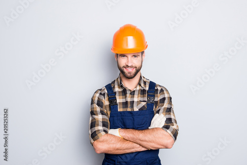 Fotografia  Portrait of cheerful positive repairer in shirt and overall looking at camera is