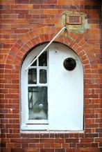 White Window On Brick Façade