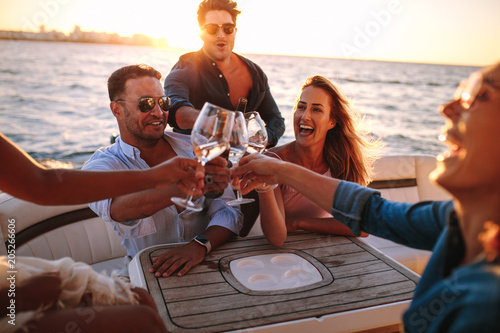 Friends on yacht drinking together Fototapeta