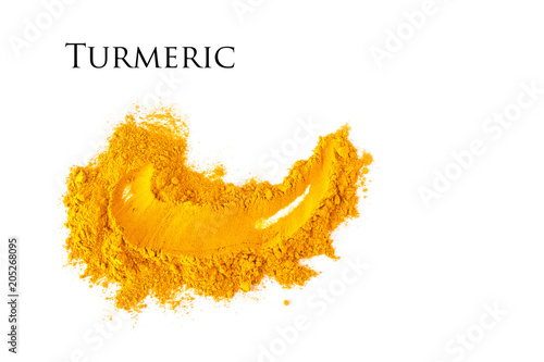 Fototapeta Smear of turmeric. Isolated on white. Empty space for text or inscription. obraz