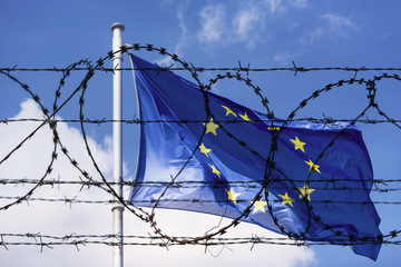 Fototapeta EU Flag and fence with barbed Wire concept Picture