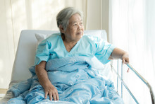 Elderly Patient Alone In Bed. ...