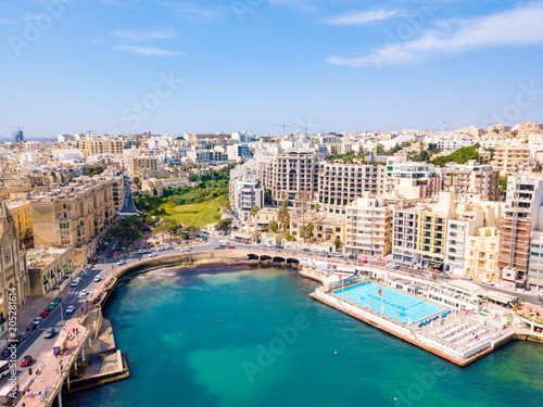 Fototapeta ST.JULIAN'S, MALTA, MAY 15, 2018 - Aerial view on the Spinola Bay with outside pool in St.Julian's from above - St.Julian's, Malta obraz