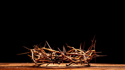An authentic crown of thorns on a wooden background. Easter Theme