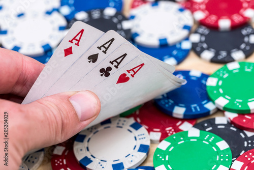 Poster  Card combination from aces on casino chips background