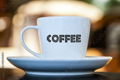 Fotografie, Obraz  Coffee cup on a table with bokeh background