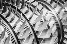 Steel Blades Of Turbine Propeller. Close-up View. In B/W. Selected Focus On Foreground