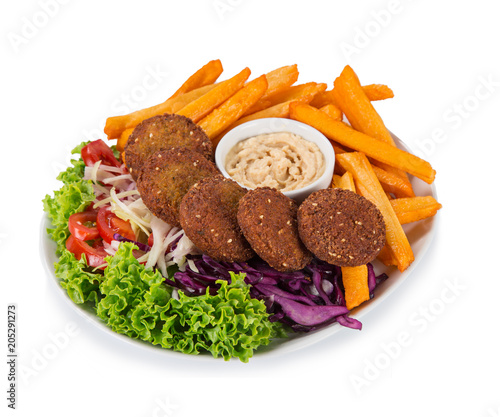 Falafel plate with fresh vegetables, hummus and french fries.