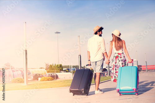 Young couple traveling with luggage