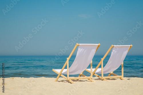 Tableau sur Toile Deck chairs on beach