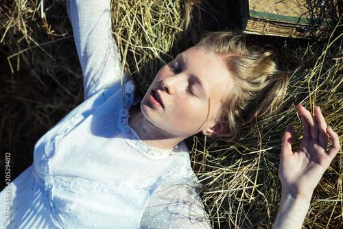 Fotografie, Obraz  Albino girl sleep on hay