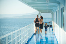 Family With Son Walking On Cruise Liner Deck, Full Body.