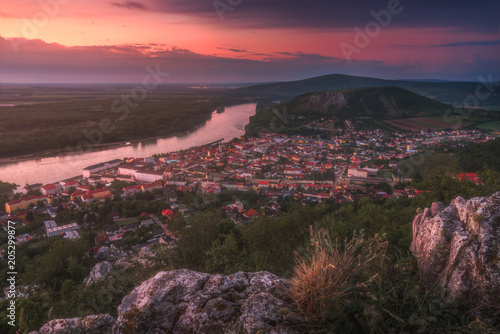 In de dag Crimson View of Small City of Hainburg an der Donau with Danube River as Seen from Rocky Hundsheimer Hill at Beautiful Sunset