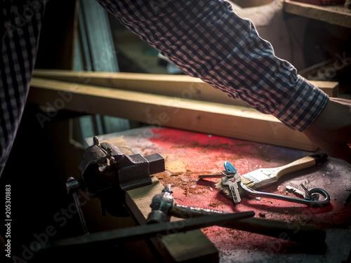 Fotografie, Obraz  close up master crafting keys in the workshop