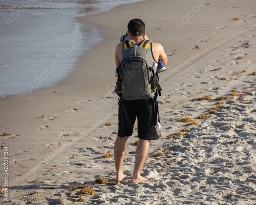 Fotografia  unknown photographer has found his next picture while at the beach and on vacati