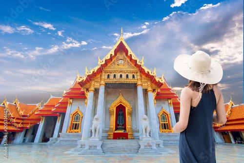 Deurstickers Bedehuis Women tourists wearing hat
