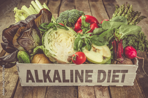 Alkaline diet concept - fresh foods on rustic background Canvas Print