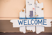Wood Welcome Sign Hanging On R...