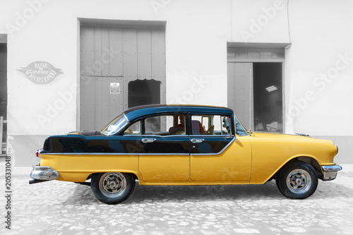 Yellow taxi in the streets of Trinidad Cuba Wallpaper Mural