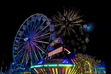 July 18, 2017 VENTURA CALIFORNIA - Illuminated Ferris Wheel With Neon Lights And Fireworks At The Ventura County Fair, Ventura, California