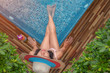 woman in bikini joyful and delight cheerful with bath spa outdoor, surrounding with palm trees freshery place in private zone