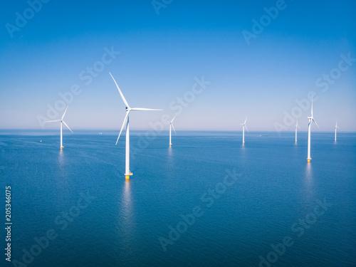 Fototapeta drone view at an windmill farm at sea obraz