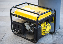 Gasoline Portable Generator On The House Construction Site. Close Up On Mobile Backup Generator .Standby Generator - Outdoor Power Equipment