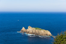 Villano Island On Sunny Day By Cantabrian Sea On The Coast Of Biscay. Natural Landscape On Blue Ocean