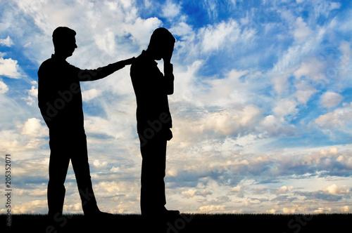 Obraz A silhouette of a man morally supports a sad man - fototapety do salonu