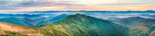 Poster Panoramafoto s Panorama with landscape of mountains and blue hills at sunset