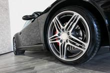 Black Sport Car On Showroom Fl...