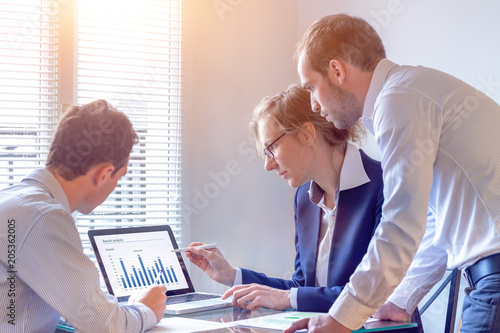 Fotografía  Accounting team discussing financial report data, office, consultant business st