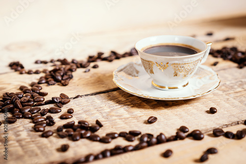 Foto op Aluminium Cafe cup of delicious and fragrant coffee on a wooden old table with seeds