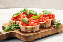 Fresh Tomato Bruschetta. Italian Food Appetizer With Basil