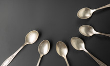 Old Silver Spoons On Black Background