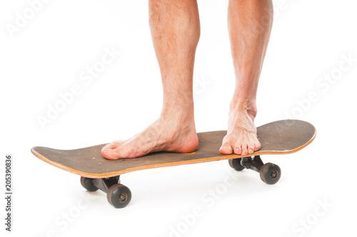 Fotografie, Obraz  Man`s skateboarder legs close up isolated on white background
