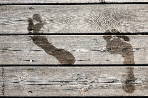 Wet Footprints On A Wooden Jetty Bridge Concept For Swimming
