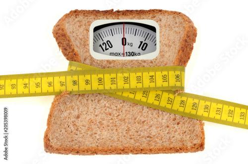Fotografie, Obraz  Concept de pèse-personne avec une tranche de pain de mie