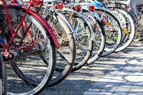 Photo Stands Bicycle Old bikes on a bicycle parking lot.