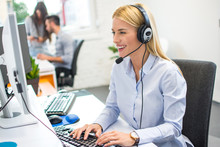 Beautiful Business Woman With Headset Working In Office