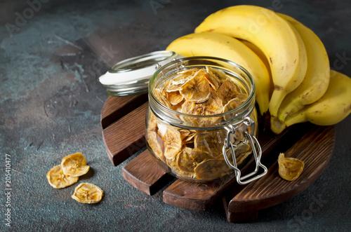 Homemade banana chips in a glass jar