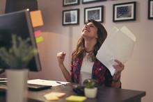 Woman Holding Documents Joyful After A Business Success