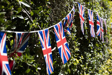 Union Jack Flags Hang In Winds...