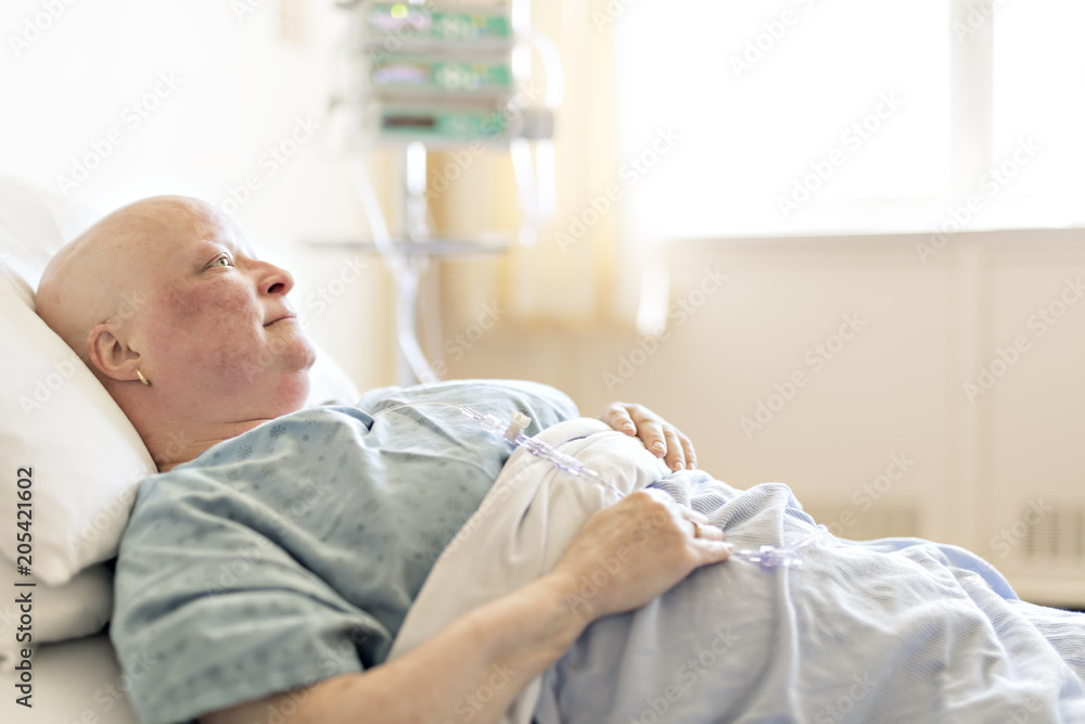 Photo & Art Print woman in hospital bed suffering from