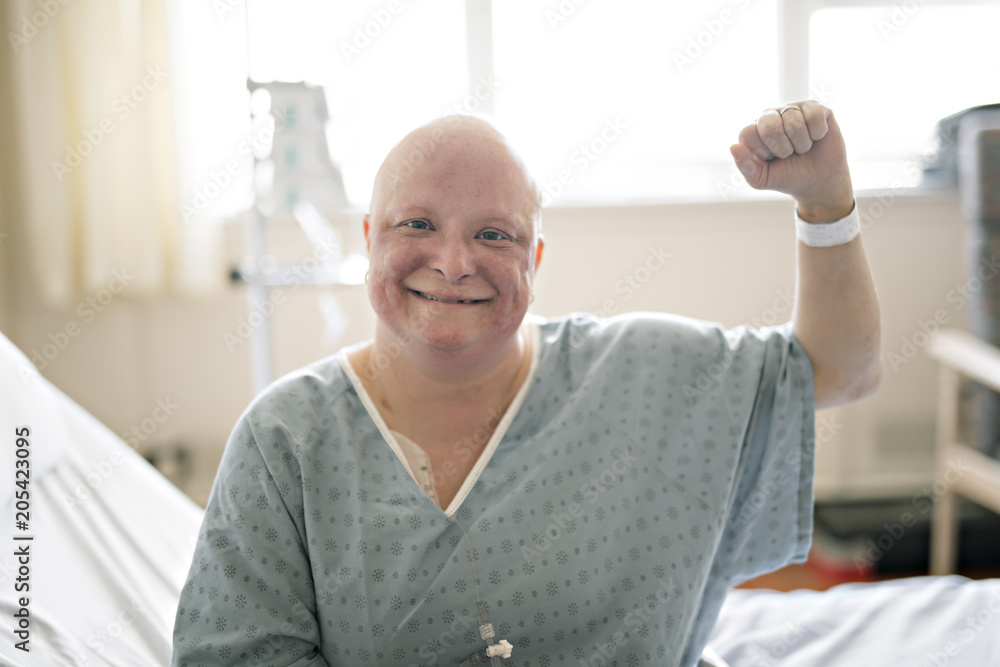 Fototapeta woman in hospital bed suffering from cancer