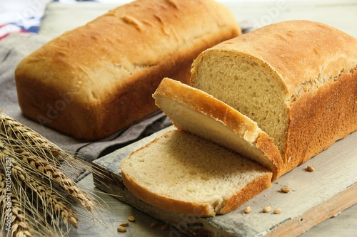 Homemade bread loaf sliced, selective focus Canvas Print